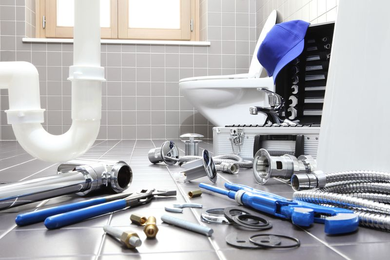 plumber tools and equipment in a bathroom, plumbing repair service, assemble and install concept